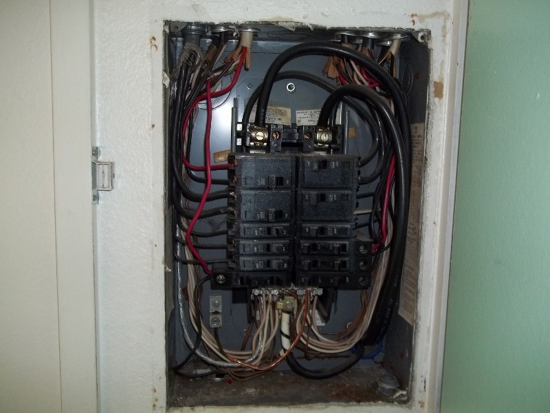 Electrical service panel without cover | Ketchikan Home Inspections LLC